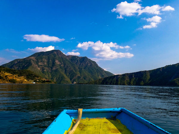 Summer Exploratorium Mountains And Lakes Beauty In Nature EyeEm Selects Water Mountain Nautical Vessel Tree Blue Lake Kayak Sky Mountain Range Pedal Boat Outrigger Standing Water Moored Countryside Boat Calm Floating On Water