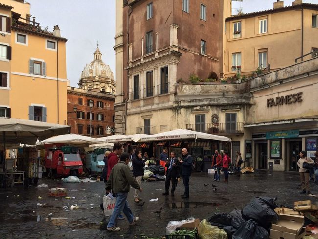 At The end of working day in Campo de Fiori Real People City Life Streetphotography Architecture Building Exterior Market Garbage IPhoneography Iphonegraphy