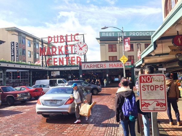 Market Multi Colored Building Exterior Architecture Built Structure Real People Sky City Seattle Market Pike Place Market Lifestyles Outdoors Day Text Mode Of Transport Land Vehicle Women One Person People Adult The Traveler - 2018 EyeEm Awards