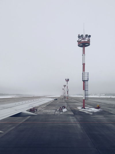 Landing Zone Airport City Sky Lighthouse Guidance Weather Vane Foggy Direction Empty Road