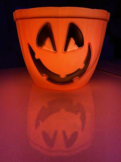 Close-up of face on illuminated halloween pumpkin