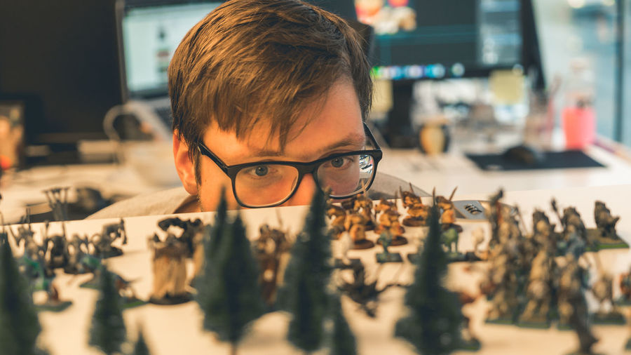 Man looking at miniature models
