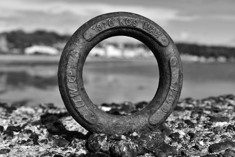 Travel Seetheworld  EyeEm Best Shots EyeEmNewHere EyeEm Nature Lover Travel Destinations Water Metal Close-up Geometric Shape Rusty Focus On Foreground Circle Nature Land Sea Beach No People Day Shape Sky Outdoors Solid Old Obsolete Wheel Deterioration Tire