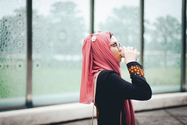One Person Lifestyles Young Adult Looking Real People Clothing Standing Window Adult Women Focus On Foreground Day Waist Up Young Women Side View Leisure Activity Looking Away Hijab Beautiful Woman Outdoors Contemplation Profile View