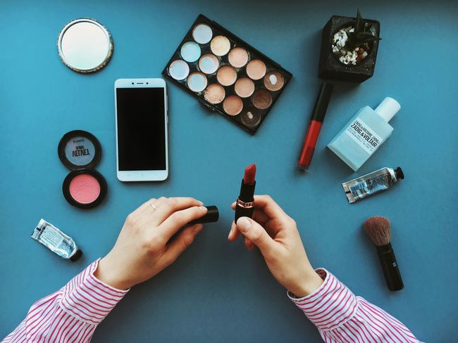 Makeup today Make-up Makeup Cosmetic Products Cosmetics & Glamour Hands Table Womanofstyle Woman Power Laptop Human Hand High Angle View Human Body Part Table Indoors  Women Directly Above Real People Technology One Person Close-up People Day Modern Workplace Culture