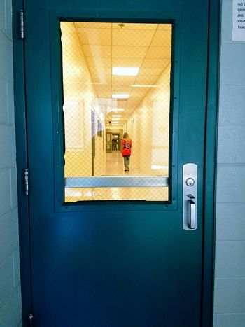 Walking away to get booked into jail for a couple days. Door One Person Young Adult Sad Walking Away Leaving Booked Young Woman Red Jail Prisoner Inmate Real Life Life Lessons Misdemeanors Adult People Rear View Full Length Indoors  Love Sadness
