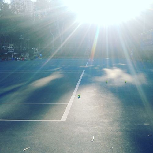 Sport Tenniscourt Tennis Ball Lens Flare Sunbeam Outdoors Sunlight No People Sun Day Green Favorite Sport Ball Round