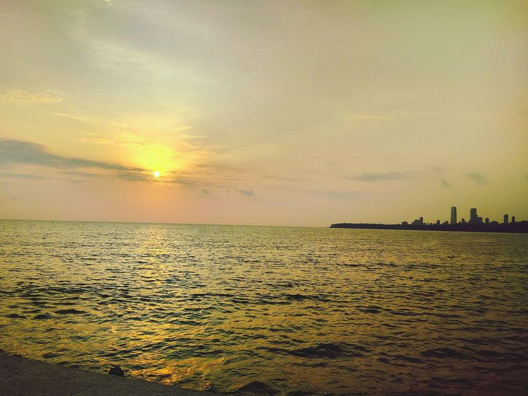 People And Places Beauty In Nature Color Of Technology Monsoonmagic Battle Of The Cities Golden Sunset Sea Water Horizon Over Water Beach Scenics Sun Tranquil Scene Sunset Tranquility Sky Beauty In Nature Seascape Idyllic Shore Nature Non-urban Scene Majestic Tourism Vacations