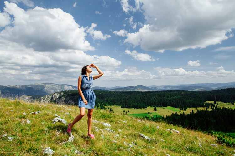 woman relax on peak of mountain. Travel to mountains with picturesque view. Montenegro, Zabljak. Adult Beauty Beauty In Nature Casual Clothing Cloud - Sky Day EyeEm Best Edits Females Freedom Happiness Landscape Leisure Activity Mountain Nature One Person One Woman Only Outdoors People Picturesque Portrait Relaxation Scenics Sky Vacations Women
