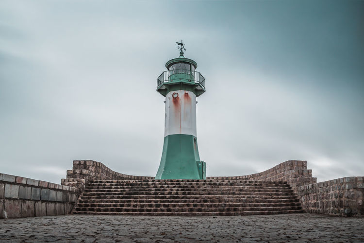 Low angle view of lighthouse against building