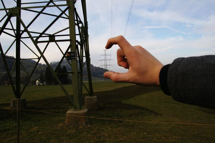 Sky Human Hand One Person Human Body Part One Man Only Close-up Power Supply Power Lines Power Cable