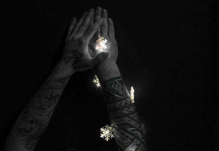 Human Hand Hand Illuminated Human Body Part Adult Indoors  Lifestyles Body Part Studio Shot Lighting Equipment Black Background Copy Space Night Glowing Tattoo Burning Black And Colors Holding In Darkness Art And Craft ArtWork Creativity Tattoo Arm Tattoo Art Light And Shadow