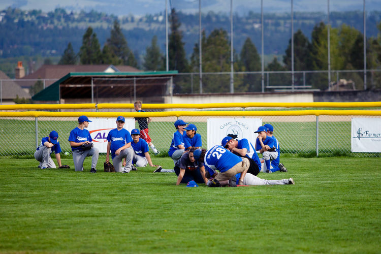 Baseball Coach Competitive Sport Emt Field Grass Injury Lawn Lifestyles Mountains Outdoors Playing Field Respect Small Town Sport Take A Knee Teamwork