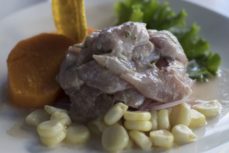 ceviche de pescado en peru Ceviche CevichePeruano Fish Grains Corn Food EyeEm Selects Food Food And Drink Indoors  Meat Plate Ready-to-eat Healthy Eating No People Close-up Freshness