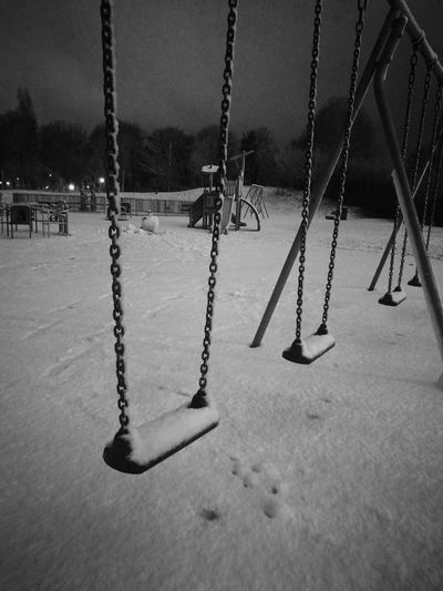 Playground Swing Chain Childhood Outdoor Play Equipment Park - Man Made Space Outdoors No People Snow Night