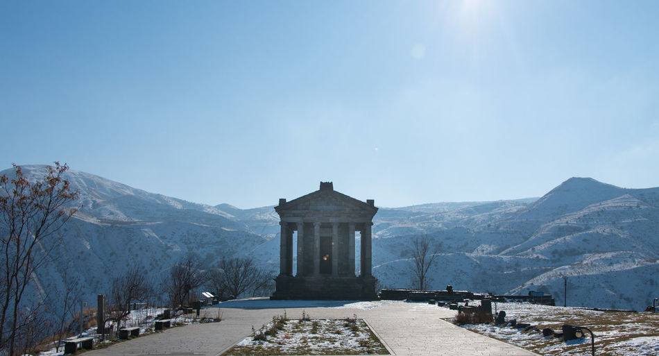 Ancient Greek Architecture Armenia Beauty In Nature Clear Sky Cold Temperature Cultures Garni Hellenistic  Landscape Monument Mountain Mountains Nature No People Outdoors Place Of Worship Scenics Sky Snow Sun Temple Temple Travel Travel Destinations Winter