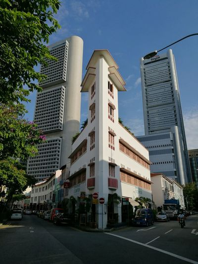 EyeEm Selects Architecture Skyscraper Modern Public Building Built Structure Travel Destinations Building Exterior Outdoors Sky Shop Houses Singapore Singapore Life Singapore City Singapore View City Day Urban Skyline Intersection ChoicesInLife Choices We Made Decisions Forked Road Forked Path An Eye For Travel