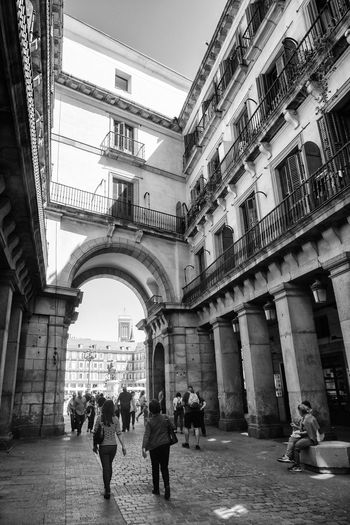 plaza mayor, madrid Madrid SPAIN Travelling Arch Architectural Column Architecture Building Building Exterior Built Structure City Day Geometry Group Of People History Leisure Activity Lifestyles Light And Shadow People Plaza Mayor Real People Travel Destinations Urban Urban With History Walking