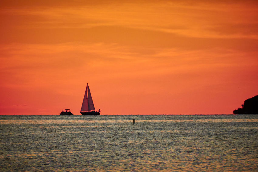 Atmosphere Beauty In Nature Cloud Cloud - Sky Cloudy Colorful Distant Escapism Getting Away From It All Horizon Over Water Lake Moody Sky Orange Color Outdoors Scenics Sea Silhouette Sky Sunset Tranquil Scene Tranquility Water