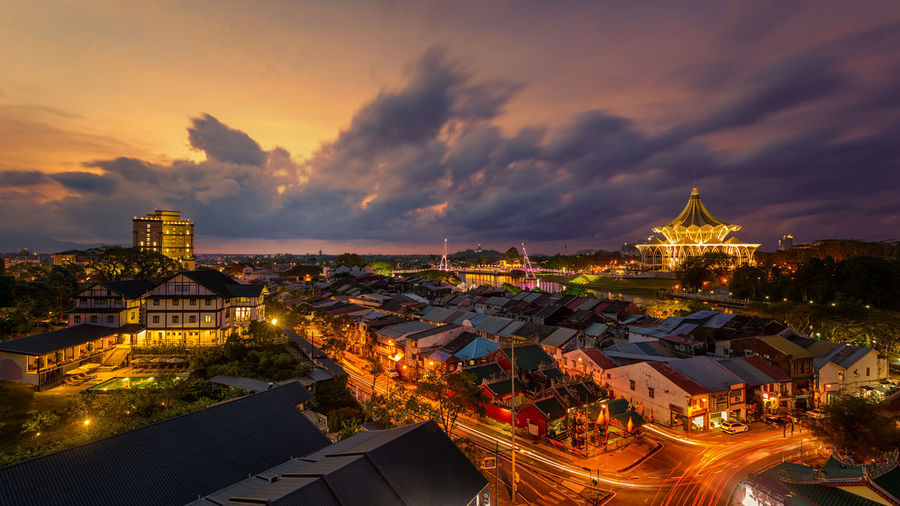 Sunset in Kuching Sunset, Kuching, Sun, Town, City Building Built Structure City Cityscape Cloud - Sky High Angle View Illuminated Nature Night Sky Sunset Travel Destinations