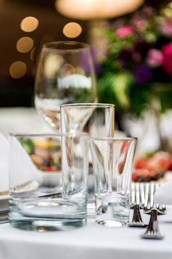 Empty glasses set in restaurant Banquet Holiday Set Table Setting Table Arrangements Wedding Reception Alcohol Catering Celebration Event Close-up Crystal Drinking Glass Empty Food And Drink Glass Glassware No People Nobody Place Setting Restaurant Selective Focus Table Tablecloth Vertical Wineglass