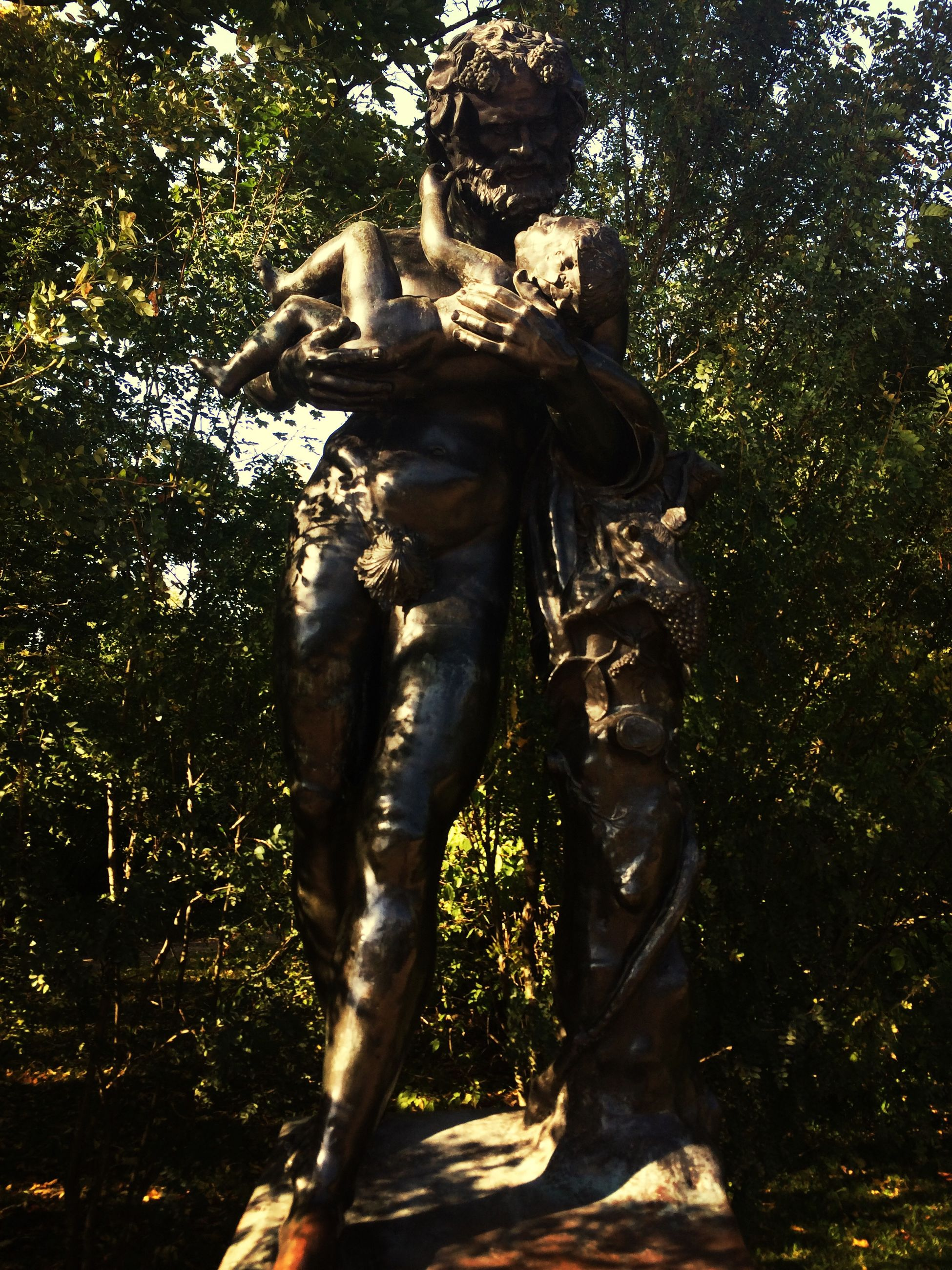 tree, statue, sculpture, human representation, sunlight, nature, day, outdoors, art, growth, forest, no people, art and craft, field, branch, creativity, park - man made space, shadow, standing