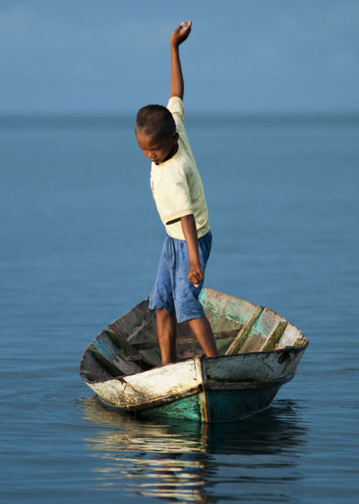 Boy on boat in sea