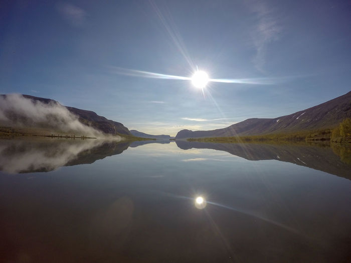 Sky Lake Water Tranquility Tranquil Scene Sun Reflection Beauty In Nature Lens Flare Scenics - Nature Sunbeam Nature Sunlight Mountain Day Non-urban Scene No People Idyllic Bright Outdoors Solar Flare Sarek