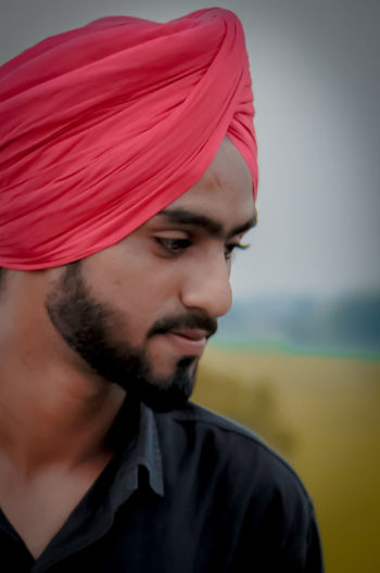 Close-up of man wearing turban standing outdoors