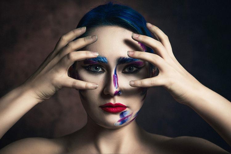 Portrait of woman with face paint
