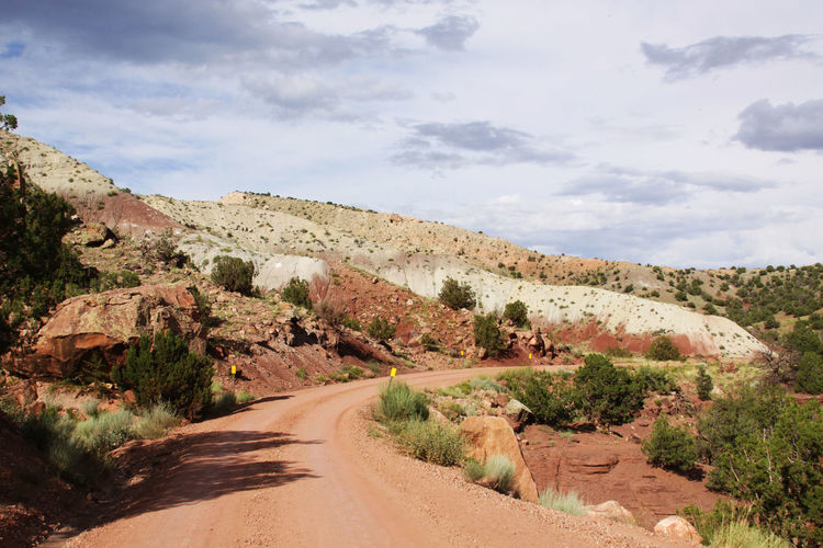 Narrow Curved Road Along Rocky Landscape