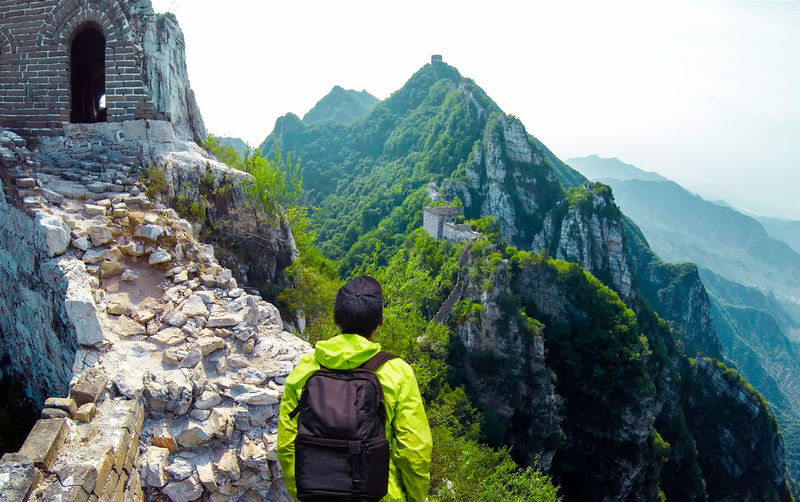 Rear View Of Man With Back Pack Looking At Great Wall Of China