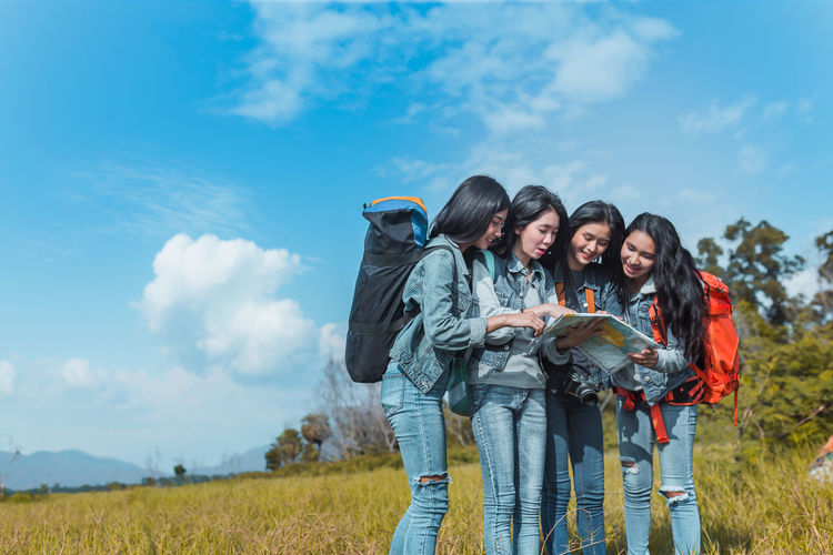 Group of Young Asian women looking map travel trekking to destination in vacation time for go to camping. Cloud - Sky Group Of People Women Togetherness Sky Field Nature Standing Leisure Activity Young Adult Land Young Women Real People Emotion Smiling Casual Clothing Happiness Day Three Quarter Length Outdoors Teenager
