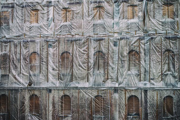 Full frame of tarp covered building