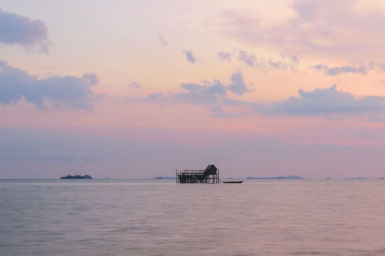 Wooden House Wooden Blue Hour Evening Sky Evening Light Pastel Colors Backgrounds Copy Space Nautical Theme Floating On Water Water Sea Sunset Nautical Vessel Beach Sky Horizon Over Water Architecture Building Exterior Built Structure Seascape Calm Dramatic Sky Stilt House Atmospheric Mood Moody Sky Ocean Coastline Romantic Sky Coastal Feature