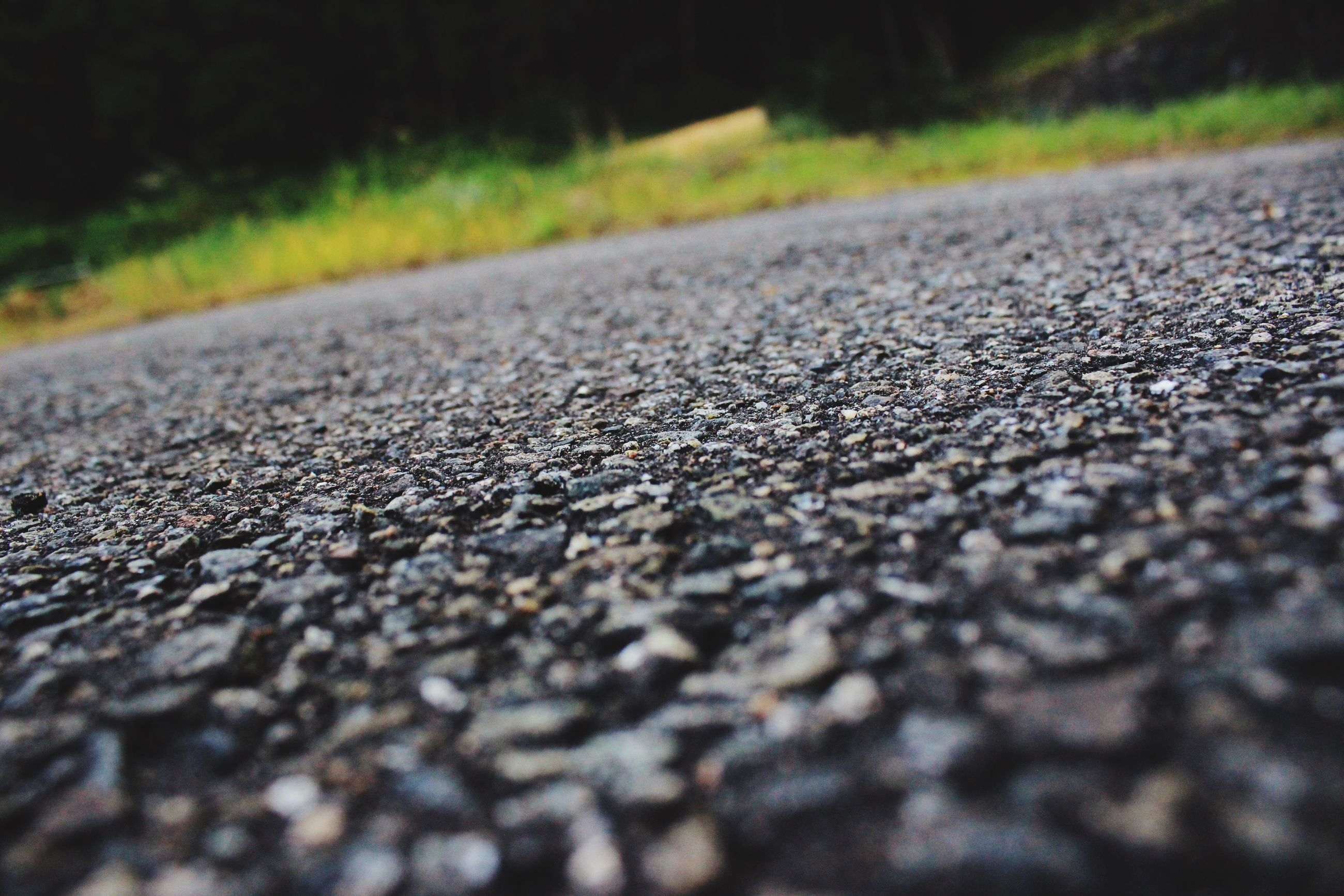 selective focus, nature, surface level, no people, asphalt, day, road, outdoors, transportation, the way forward, beauty in nature, close-up, pebble beach