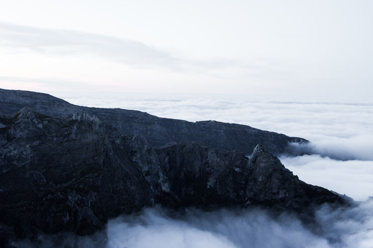 Above the clouds on Pico de Ariero. My Best Photo Beauty In Nature Scenics - Nature Sky Mountain Cloud - Sky Rock Nature Tranquil Scene Tranquility Non-urban Scene Rock - Object Day No People Solid Environment Water Land Outdoors Idyllic Volcanic Crater Above Clouds Madeira Pico De Arieiro Clouds