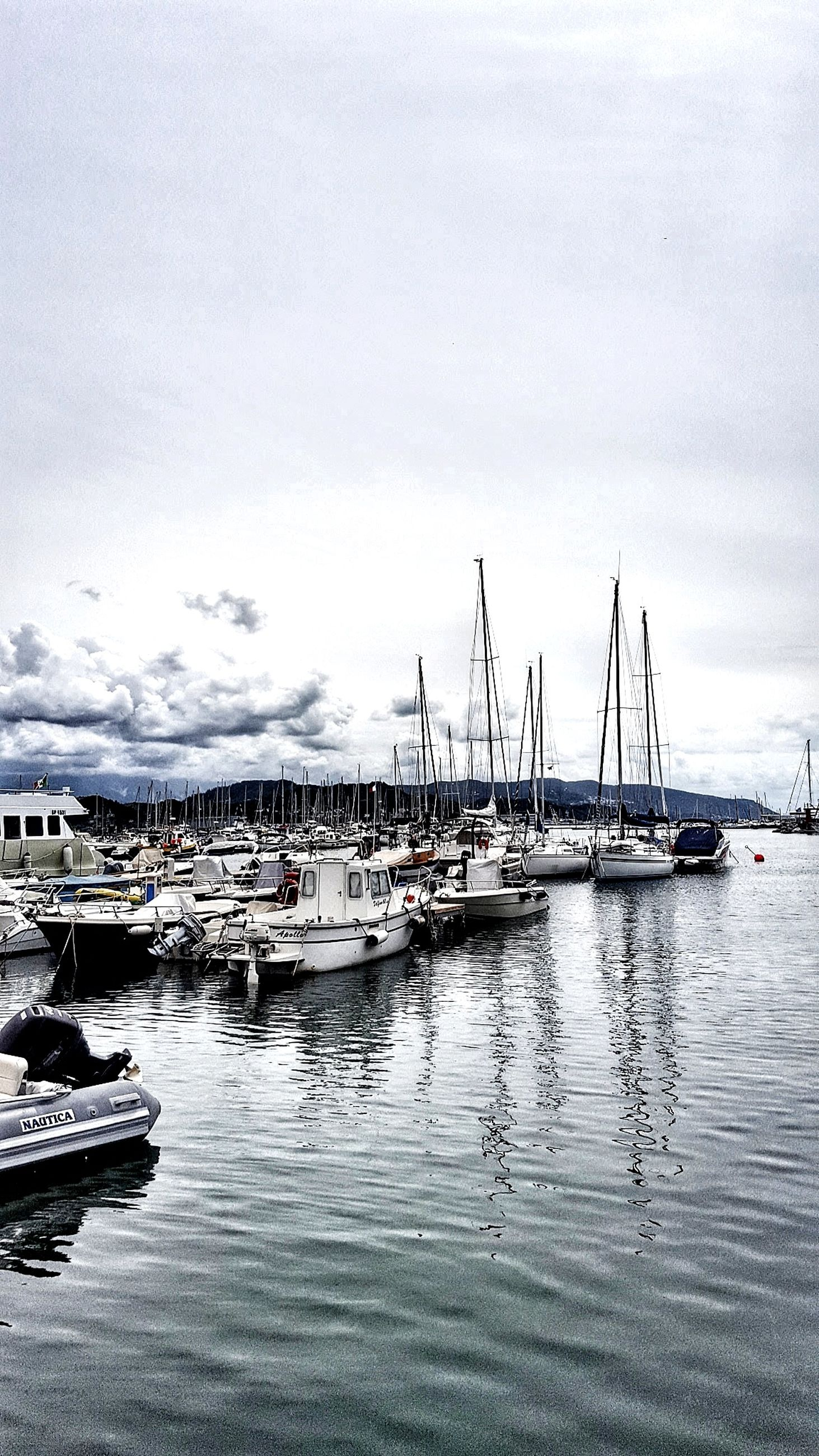 nautical vessel, moored, transportation, harbor, mode of transport, water, sky, no people, reflection, day, cloud - sky, outdoors, sea, mast, nature, yacht