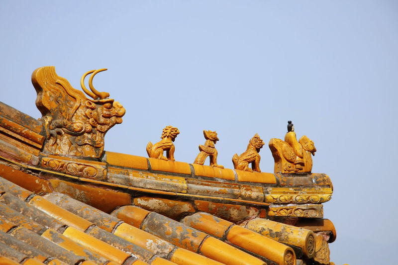 Animal Representation Architecture Building Exterior Built Structure Chinese Chinese Culture Chinese Dragon Clear Sky Day Gargoyle Gold Colored History Low Angle View No People Outdoors Place Of Worship Religion Sculpture Sky Statue Paint The Town Yellow
