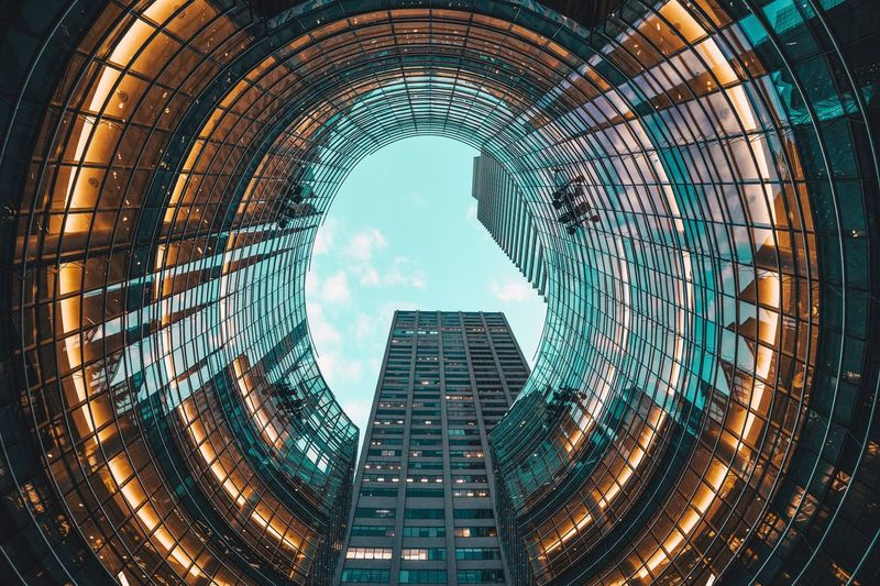 Circle Skyscraper Illuminated Architecture City Modern Built Structure Building Exterior Sky No People Outdoors Cityscape Day EyeEmNewHere The Secret Spaces Art Is Everywhere The Street Photographer - 2017 EyeEm Awards
