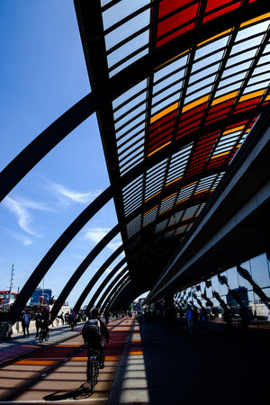 Amsterdam Amsterdam City Architecture Colours Shadow And Light The Week on EyeEm Travel Travel Photography Architectural Feature Architecture Bike Built Structure Centraal Station Amsterdam City Cycling Day Lifestyles Men Outdoors Real People Train Station Transportation