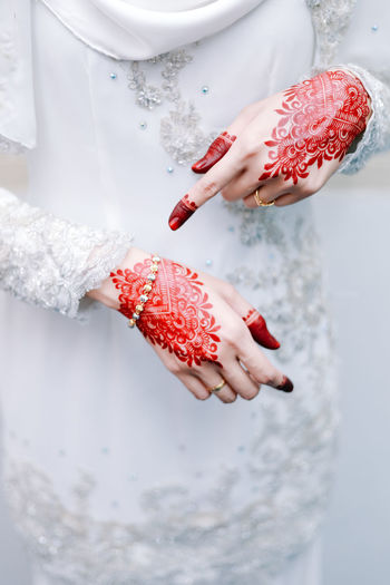 Beautiful henna on bride's hand One Person Real People Women Adult Human Hand Human Body Part Red Lifestyles Hand White Color Holding Finger Midsection Body Part Indoors  Focus On Foreground Day Human Finger Standing Nail Human Limb