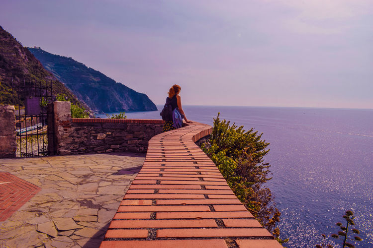 Cinque Terre Redhead Beauty In Nature Clear Sky Day Full Length Italy Leisure Activity Lifestyles Mountain Mountains Nature One Person Outdoors People Real People Scenics Sea Sea And Sky Sky Standing Water Women Young Adult Young Women