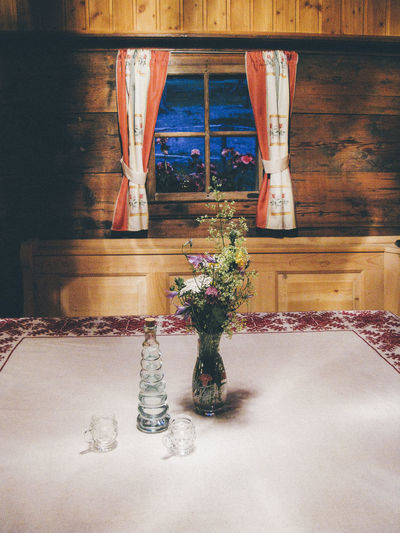 Alpine Austria Beverages Interior Views Alcohol Bottles Day Flower Flowers Home Interior Housing Indoors  No People Rustic Style Schnaps Table Traditional Vase Wood - Material