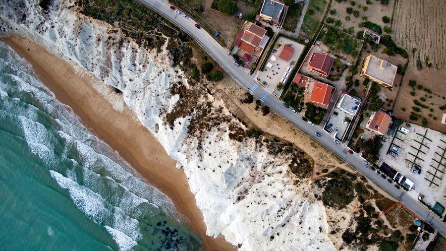 Aerial view of sea by buildings