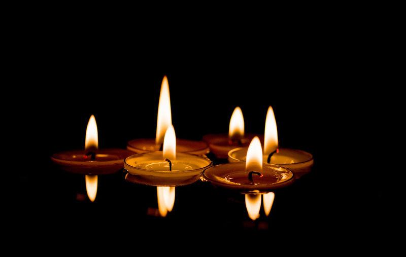 Reflection Of Burning Lamps