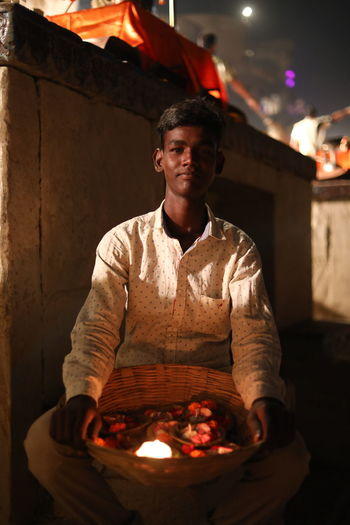Worship and Light Light And Shadow #varanasi #ghat #Ganga_arti #lightllampmaker Working Metal Industry Heat - Temperature Business Finance And Industry Front View Instrument Maker Flame First Eyeem Photo