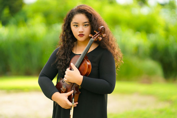 Portrait Of Young Violinist