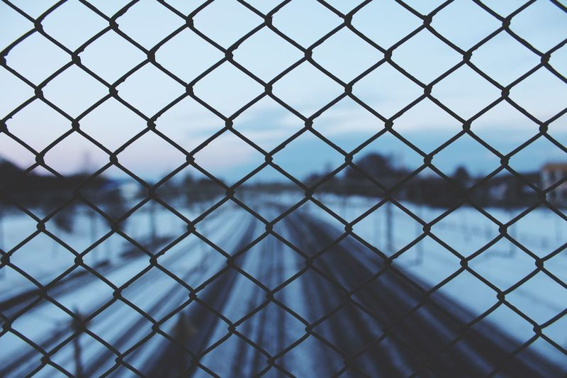 Canon EyeEm Selects Chainlink Fence Protection Metal Safety No People Focus On Foreground Water Full Frame Outdoors Nature Close-up Day Sky