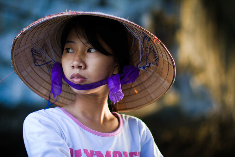 Young woman in Vietnam Beautiful Casual Clothing Childhood Chinese Chinese Hat Close-up Confidence  Cute Elementary Age Front View Girls Gorgeous Happiness Hat Hat Innocence Lady Lifestyles Looking At Camera Person Portrait Real People Vietnamese Young Girl Young Woman